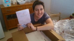 Me with my shiny new paperback copy of the First Time for Everything anthology